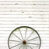 Antique Wooden Wagon Wheel On Rustic White Background Stock Images