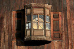 Antique wooden wall and overlapped window Royalty Free Stock Image