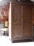 Antique wooden wardrobe in the dusty attic Royalty Free Stock Photos
