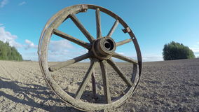Antique wooden wheel in the field, time lapse 4K stock footage