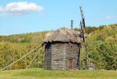 Antique wooden windmill. Antique ramshackle wooden windmill, Pirogovo, Kiev, Ukraine Stock Photo