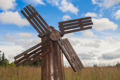 Antique wooden windmill Stock Images