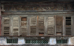 Antique wooden windows on an old building. Royalty Free Stock Images