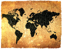 Antique world map on grunge cracked paper Stock Photos