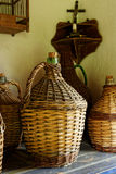 Antique Woven Wine Demijohns. Large antique wicker woven glass demijohns for transporting or storing wine in the 1950s stock photo