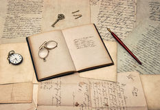 Antique writing accessories, open diary book, old letters and po. Stcards. nostalgic sentimental background Royalty Free Stock Images