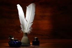 Antique Writing Feather Quills and Old Inkwells Royalty Free Stock Photos