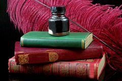 Antique Writing Materials. Antique books with quill and inkwell royalty free stock image