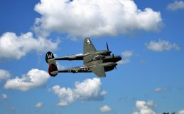 WWII 1944 P38. Antique WWII 1944 P38 in flight royalty free stock photos
