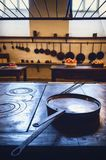 Antique XIX century old kitchen with tools, pans, pots and food ingredients. All over che benches and tables royalty free stock image