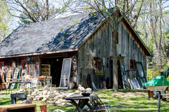 Antique yard sale. A rustic barn houses interesting treasures indoors and out at this antique yard sale royalty free stock photos