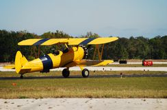 Antique yellow airplane stock photography