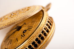 Antique yellow brass pocket watch on white Stock Image