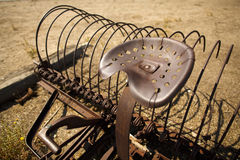 Antiqued Rusted Farm Rake and Seat Royalty Free Stock Images