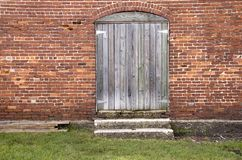 Antiqued Wooden Door Brick Wall Stock Images