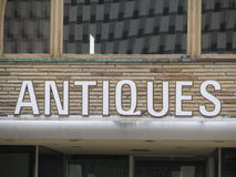 Antiques. Antique sign on an old antique store in downtown Bay City, Michigan Royalty Free Stock Photography