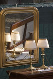 Antiques. Antique lamps and mirror with reflection Stock Photos