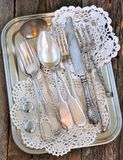 Antiques - cutlery, spoons, forks, knives on a tray Royalty Free Stock Images