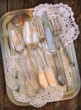 Antiques - cutlery, spoons, forks, knives on a tray Stock Images
