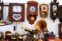 Antiques fair market wall old clocks Royalty Free Stock Images