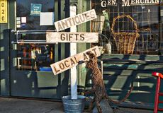Antiques, Gifts and Local Art Sign Stock Images