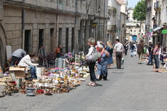 A antiques market in the old Montpellier. An antiques market in the old town of Montpellier, on May 7th 2011. In the background, one of  Montpellier university ( Stock Images
