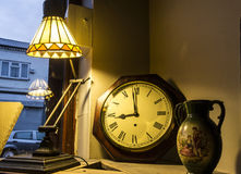 Antiques. Nicely lit set of antiques including a lamp, clock and a vase Royalty Free Stock Image