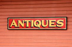 Antiques For Sale Sign. Photographed antiques for sale sign at store front in Georgia Royalty Free Stock Photo