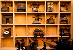 Antiques shelf in landscape mode. Wooden shelf full of antiques and vintage objects Royalty Free Stock Photo
