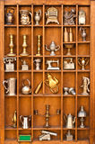Antiques shelf in portrait mode. Wooden shelf full of antiques and vintage objects Royalty Free Stock Photo