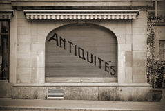 Antiques Shop. A closed antiques shop with french writing in sepia toned black and white Royalty Free Stock Images