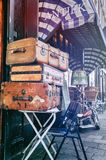 Antiques shop with vintage travel suitcases Royalty Free Stock Photos