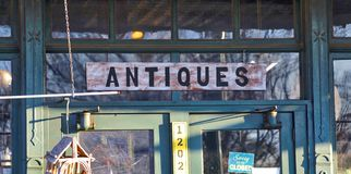 Antiques Shop Welcome Sign. Advertising sign outside a Fine Antiques and collectibles shop Royalty Free Stock Image