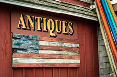 Antiques Sign. An old fashioned antiques sign on a rural shop Stock Photography