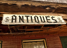 Antiques sign. Old, weathered antiques sign of a rural country store Stock Photography