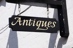 Antiques sign on wall, Tewkesbury. Royalty Free Stock Photos