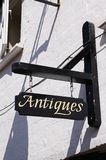 Antiques sign on wall, Tewkesbury. Royalty Free Stock Photography