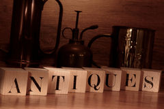 Antiques Word Spelled with Old Letter Blocks Stock Photo