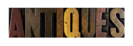 Antiques. The word ANTIQUES written in isolated letterpress type Royalty Free Stock Photos