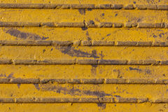 Antiskid pavement. Texture of yellow antiskid pavement Stock Images