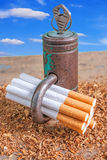 Antismoking background with broken cigarettes and a padlock Royalty Free Stock Image