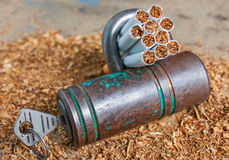 Antismoking background with broken cigarettes and a padlock Stock Images
