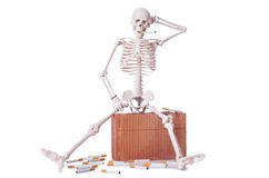 The antismoking concept with cigarettes and skull Royalty Free Stock Photos