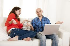 Antisocial latin couple while on laptop and tablet Stock Images
