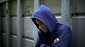 Antisocial teenager hiding from people, protesting against rules and injustice. Stock photo stock photography