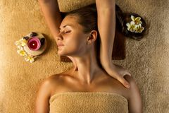 Antistress massage. The beautiful girl has massage. Stretching masage moves Royalty Free Stock Images