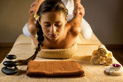 Antistress massage. The beautiful girl has massage. Stretching masage moves Royalty Free Stock Photo