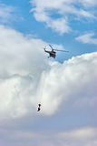 Antiterrorist action. Helicopter on the cloudy background with special forces Stock Photography