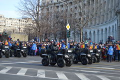 Antiterrorist brigade with atv. Bucharest, Romania, 01 December 2015 : Romanian's National Day parade. Military platoons , technical, police cars and planes Royalty Free Stock Photos