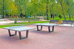 Antivandal tennis tables in the city park, under the open sky royalty free stock photos